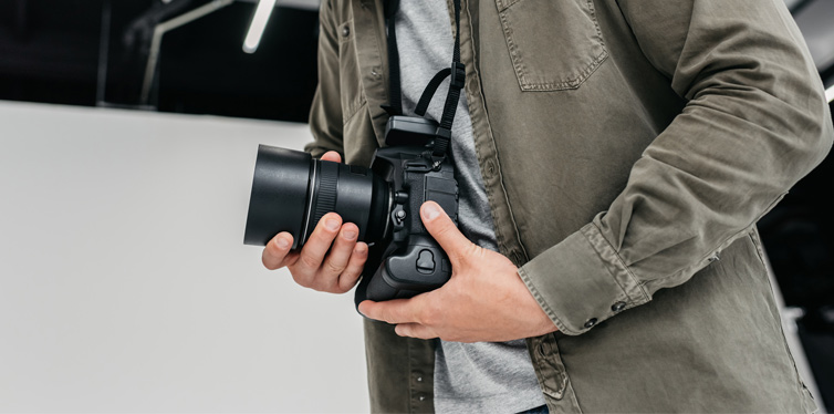 a photographer holding a camera