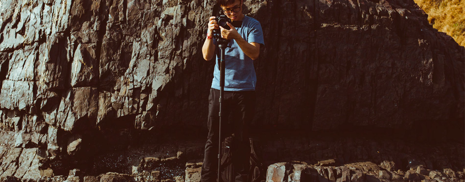 a photographer using a monopod