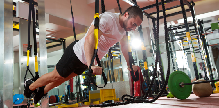 man doing trx workout