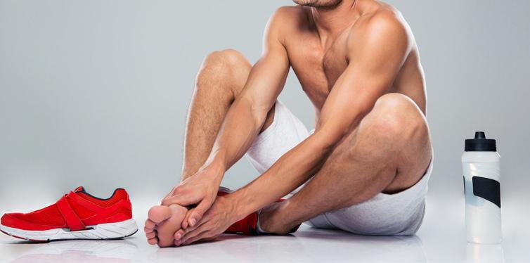 man having foot pain