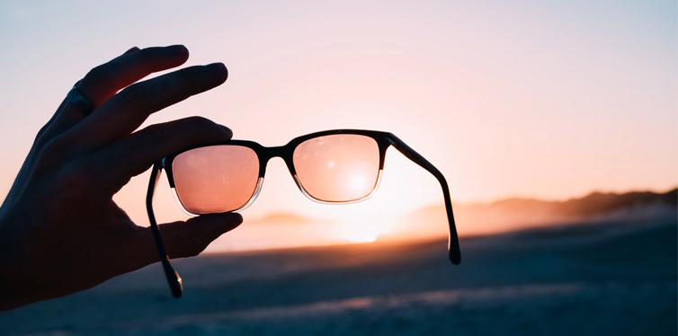 man holding sunglasses
