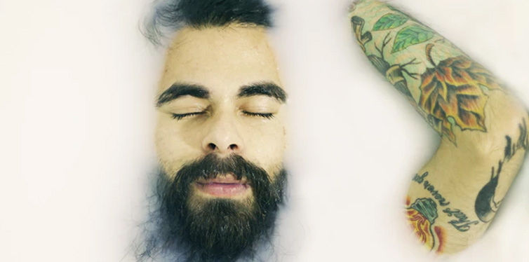 tattooed man in the bathtub