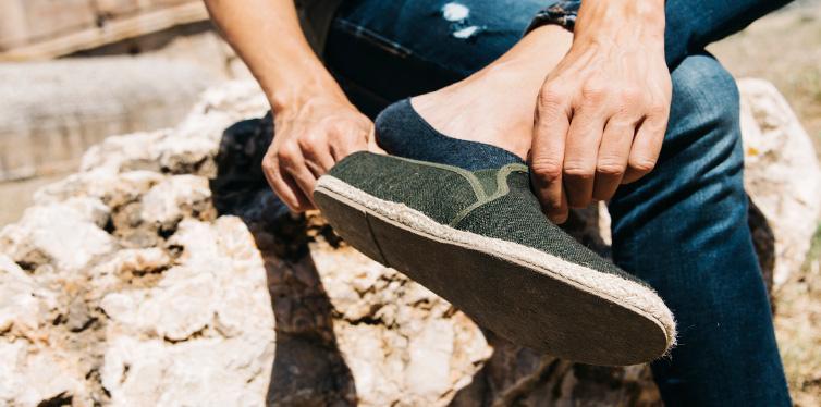 man taking his shoe off