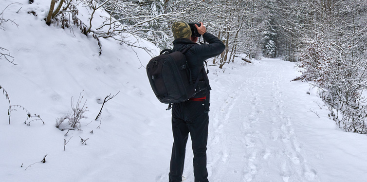 man taking photos in the winter