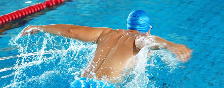 a swimmer wearing a swim cap