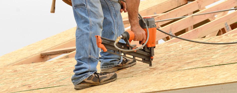 a worker using an air hammer