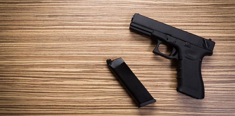 gun on the wooden table