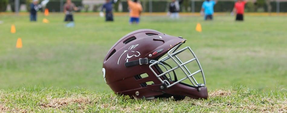 lacrosse helmet on the ground