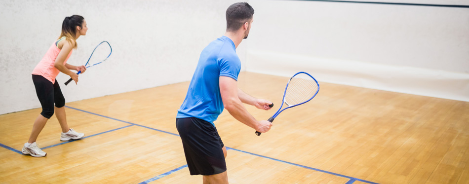 a couple playing squash