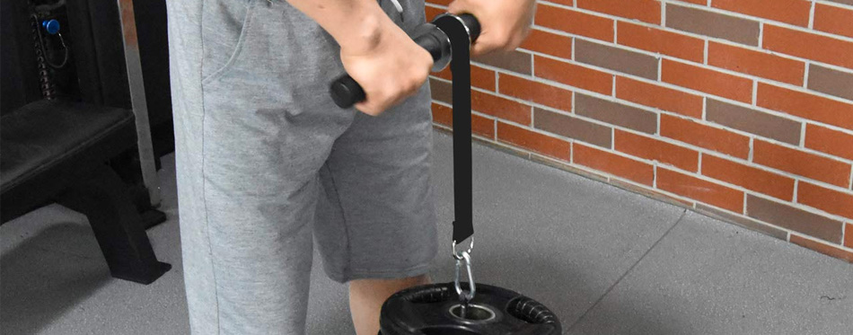 man using a wrist roller