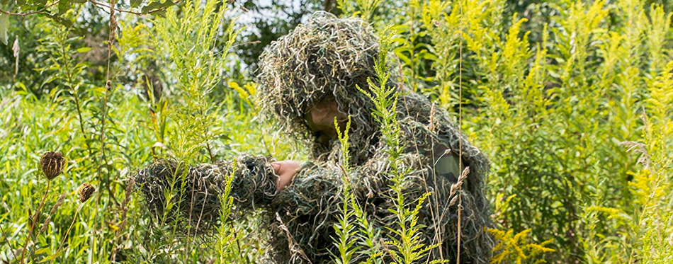 man wearing ghillie suit for hunters