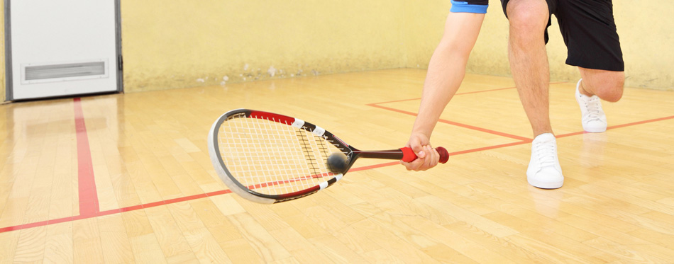 player holding a squash racket