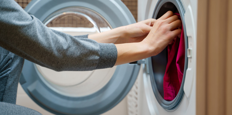 woman putting clothes to wash