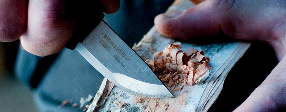 man using a neck knife