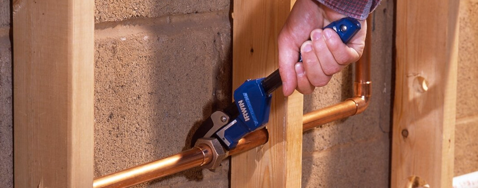 man using a pipe wrench