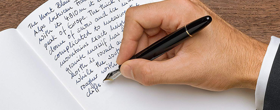 man writing with fountain pen