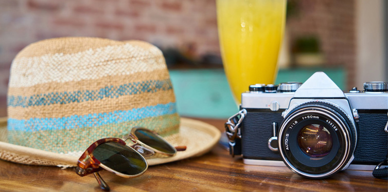 hat sunglasses and camera