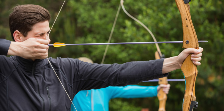 man using a bow