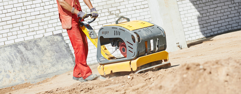 man using a concrete vibrator