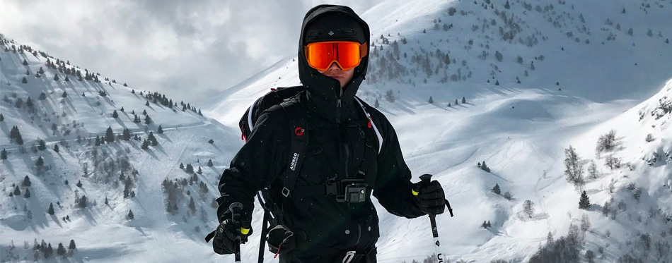 skier wearing ski jackets and goggles