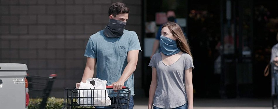 couple wearing neck gaiters over the face