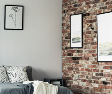 how to hang art on a brick wall