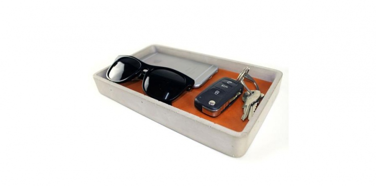 tan leather and concrete valet tray